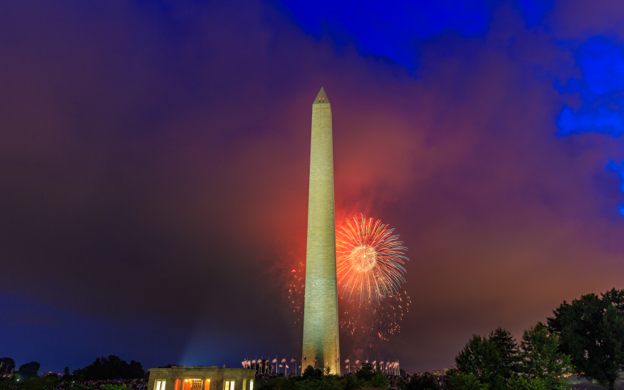 Washington DC, USA - July 04, 2015: Washington Monument stands tall with Fourth of July Fireworks in background.
